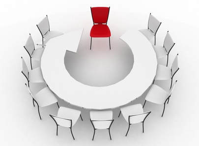 group of chairs stands at a table as an arrow